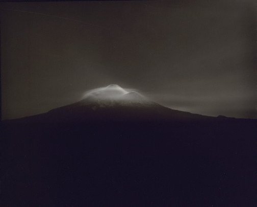 An image of Taranaki from Oeo Road, under Moonlight, 27-28 September 1999 by Laurence Aberhart