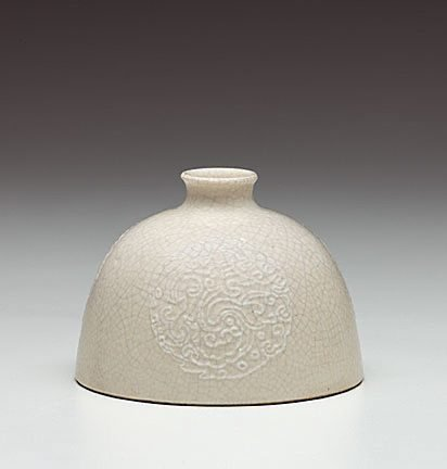 An image of Chicken coop water pot with slip trail medallion decoration by Jingdezhen ware