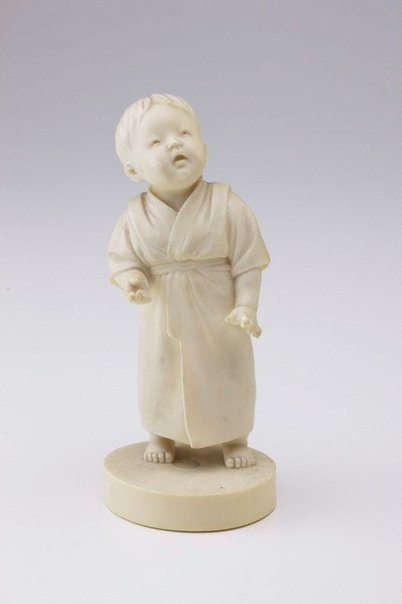 An image of Figure of a boy standing (okimono) by YÔSHI